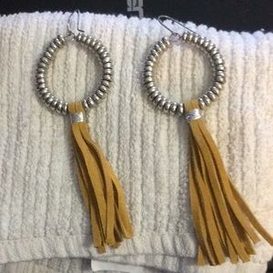 Earrings with leather fringe accents